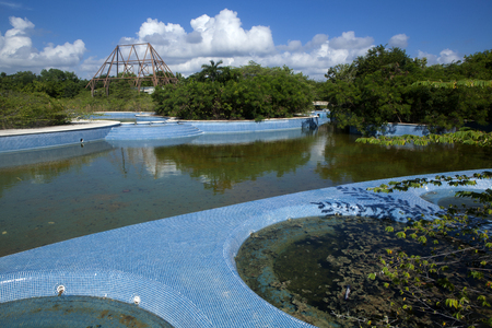 Abandon swimming pool and hottubs full of rain water serive as the perfect environment for mosquitos to breed and the spread of diseases like Zika, Malaria, West Nile