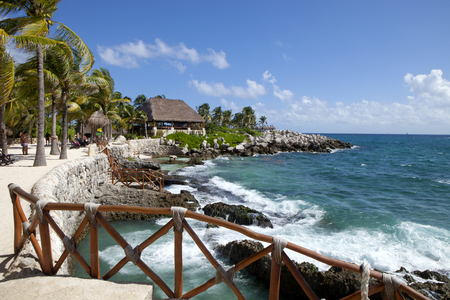 A beautiful vacation day along the Caribbean coastline of the Yucatán Peninsula in the area known as the Riviera Maya, just south of Playa del Carmen, Mexico.