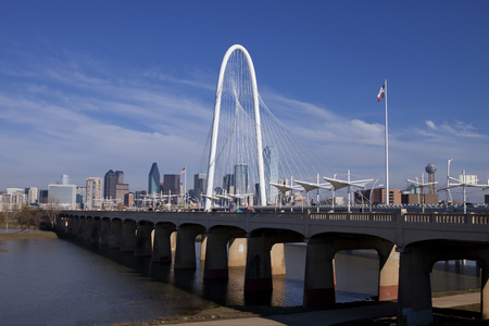 pedestrian bridges: The new Continental Pedestrian and Margaret Hunt Hill Bridges that crosses the Trinity River in Dallas, Texas. The bridge uses a unique design of a 400-foot steel arch and cables to suport the bridge. Editorial