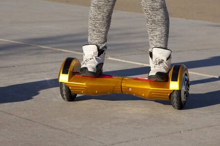 two wheel: People riding on hoverboards or gyro scoter drive. Two wheel transport device. Electriic hyroscooter driving. Driving giroscooter. Hyroscooter. Stock Photo
