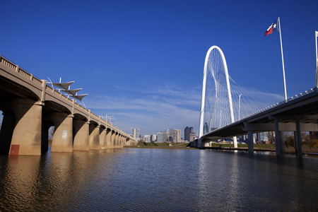 steel arch bridge: The new Continental Pedestrian and Margaret Hunt Hill Bridges that crosses the Trinity River in Dallas, Texas. The bridge uses a unique design of a 400-foot steel arch and cables to suport the bridge. Editorial