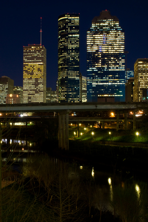 View of the downtown area of Houston from a Buffalo Bayou park at night