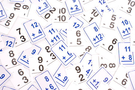 Addition math cards (blue) and subtraction math cards (black) randomly spread out on table. Educational school supplies. Edicational background Banque d'images