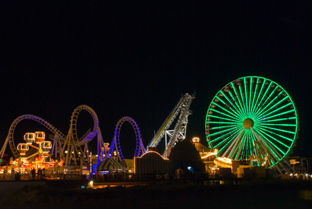 wheel spin: Amusement Pier on the beach in Wildwood , New Jeresy. Long exposure for motion blur on rides.