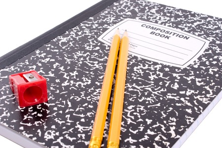 School supplies - composition book on white background