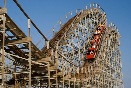 rollercoaster: Old wooden rollercoaster at an amusement park