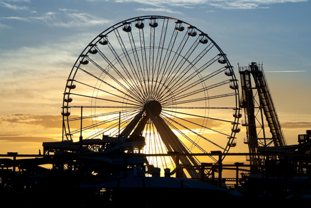 Ferris Wheel and roller coaster silhouette at sunset. Taken in Wildwood, New Jersey