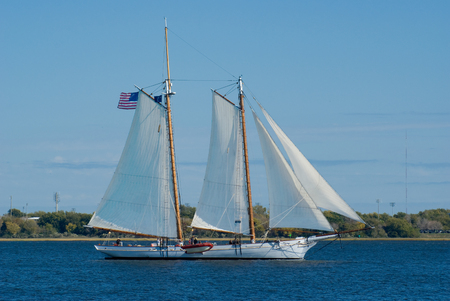 old ship: Old wooden schooner sailing ship under sail in the Cooper River in historic Charleston, South Carolina. Stock Photo