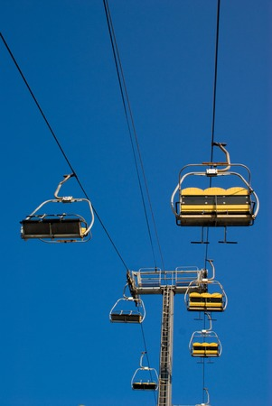 go up: Empty Sky (Ski) lift rides. Picture of two rides at an amusement park that go up and down. Stock Photo