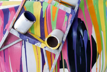 spilled paint: Spilled paint with ladder and paint cans