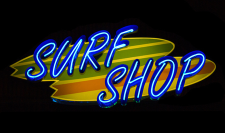 surf shop: Neon words Surf Shop with Surfboards added