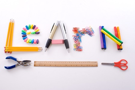 The word Learn made with school supplies on a white background