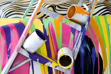 paint cans: Spilled paint with ladder and paint cans