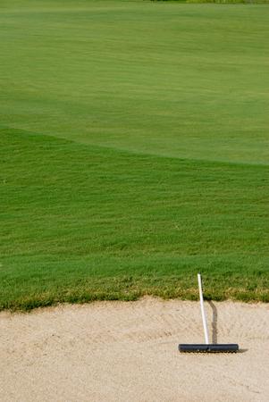 rake in a sand trap on a golf course Reklamní fotografie