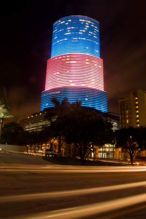 Highrise office building in Miami, Florida lit up in red white and blue