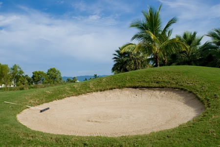 Sand trap on a tropical golf course Stock Photo