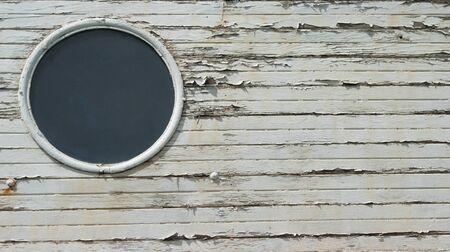 Porthole on wooden boat