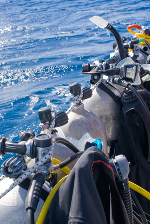 looking down on scuba tanks on a dive boat. Off center for copy space