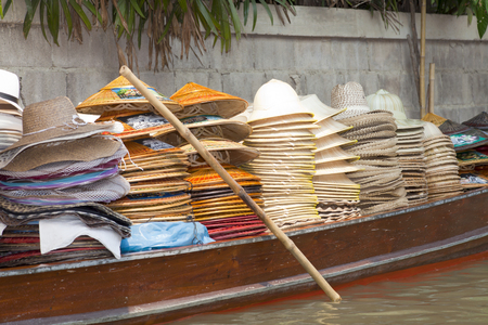 saduak: Thai hats for sale at the Famous Damnoen Saduak Floating Market southwest of Bangkok, Thailand