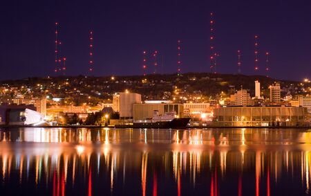 Duluth Minnesota reflected in water at Night Stock Photo