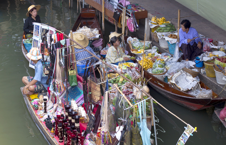 The Famous Damnoen Saduak Floating Market southwest of Bangkok, Thailand has been used in many movies from James Bond, Man with the Golden Gun to The Hangover II. Traditional Thai culture of buying and selling of plants, fruit, fish and other handcraf Editorial