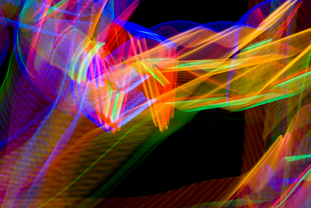 colliding: Abstract of light in motion looks like colliding rainbows