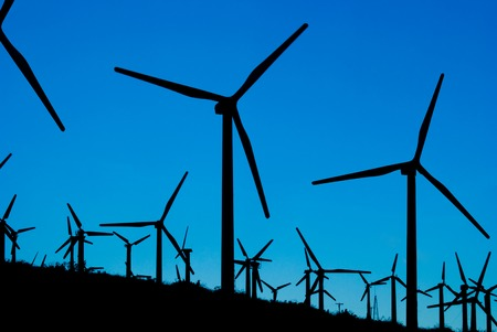 pollution free: Silhouette of modern wind mill on a wind farm in Califorina