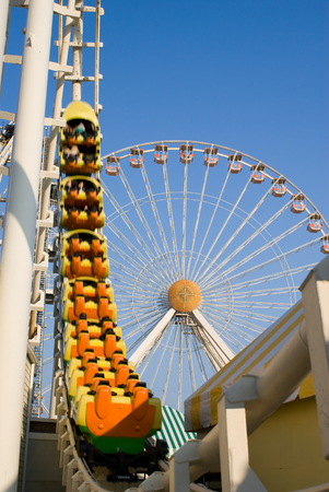 ferriswheel: Ferris wheel and Roller coaster at an amusement park