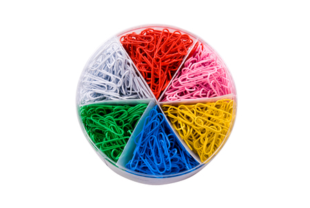 A variety of color paper clips in a container, looks like a pie chart