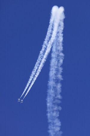 US Air Force Thunderbirds preforming precision aerial maneuvers
