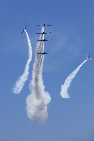 The Geico Skytypers flying preforming precision aerial maneuvers in six SNJ-2 World War II-era planes over the ocean at the Atlantic City Airshow in New Jersey Editorial