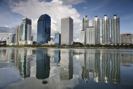 Bangkok view from the lagoon with reflex and blue sky photo