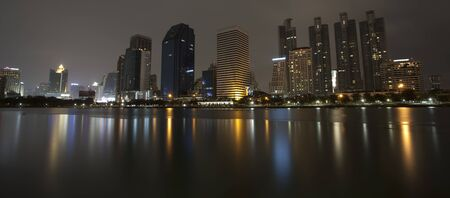 Bangkok night view from the lagoon with reflex photo