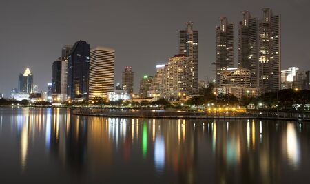 Bangkok night view from the lagoon with reflex Stock Photo - 10623558