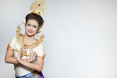 thai dance: Beautiful lady dancing for original Thai dance with golden costume. Editorial