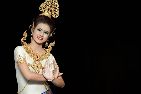 Beautiful lady dancing for original Thai dance with golden costume.
