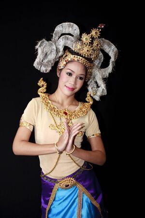 thai dancing: Beautiful lady dancing for original Thai dance with golden costume. Editorial