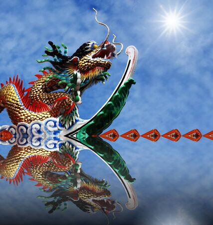 Chinese dragon with blue sky and reflex photo