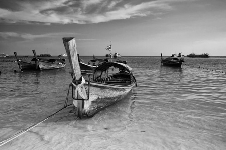 Traditional Thai Long-tail boat on the beach, at lipe island. photo