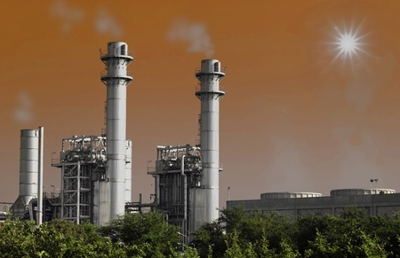 Streem power plant with sun and pollution photo