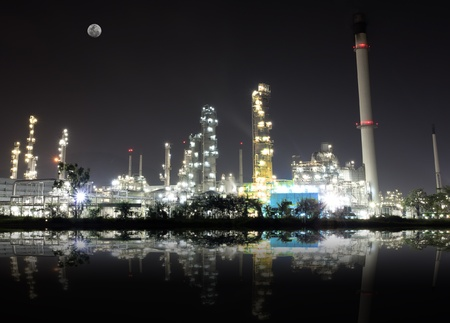 outdoor lighting: Reflex from oil refinery plant and full moon