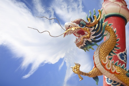 Chinese golden dragon with column and cloud background photo