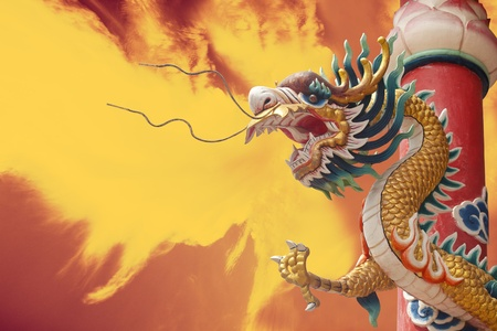 Chinese golden dragon with column and fire background photo