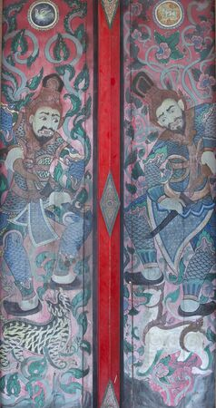 daunting: Ancient warrior picture on the door, over 200 year ago, from Wat Yai intharam in Chonburi province, Thailand.