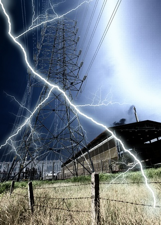 Energy tower with thunderbolt in the factory land. photo