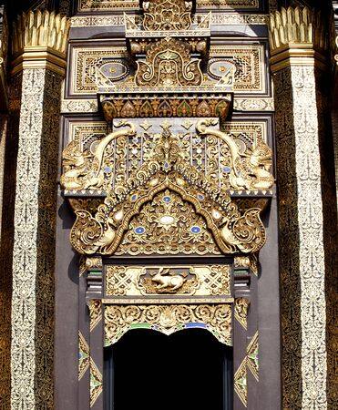 Traditional door and frame in thai architecture in the Lanna style , Royal Pavilion (Ho Kum Luang) at Royal Flora Ex photo
