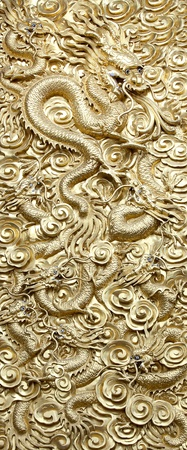 Ancient statue of golden nine dragon. photo