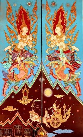 bstract: Ancien golden angel picture on the door in Thai temple. More than 200 year old picture in Wat Yai, Chonburi province in Thailand.