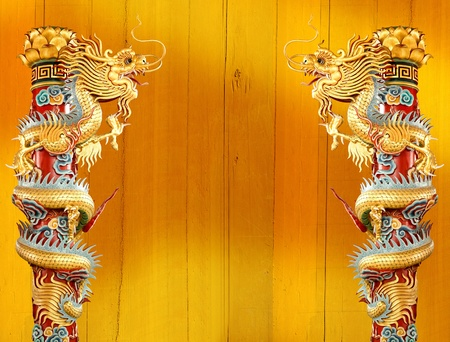 Twin Golden Chinese Dragon Wrapped around red pole on isolate background.  photo