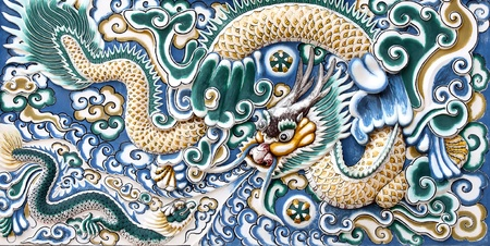 japanese dragon: Ancient mosaic tile, on the floor of Thai government park. Stock Photo
